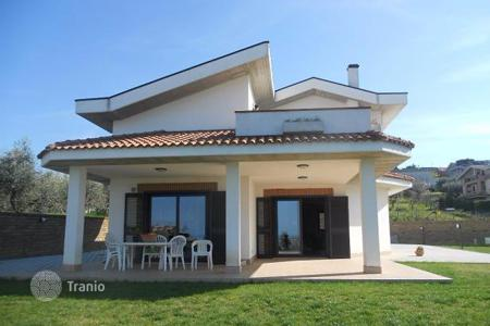 Houses for sale in Abruzzo. Villa with two terraces, a large garden and panoramic views of the sea and mountains in Montesilvano, Italy