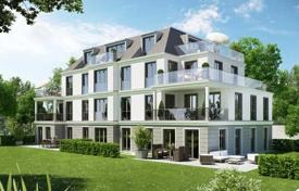 New homes for sale in Bavaria. New three-bedroom apartment with a terrace and private garden in Nymphenburg area, Munich