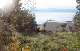 Coastal development land for sale in Croatia. Large plot of land for building with a sea view, Omis, Croatia