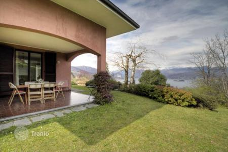 5 bedroom houses for sale in Italy. Terraced villa with a big garden and views of Lake Maggiore, on a hill, 1 km from the center of Stresa, Italy