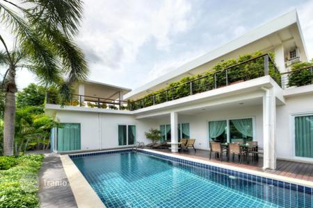 Off-plan houses for sale overseas. New villa with pool, garden and parking in Pattaya, Bang Sare area