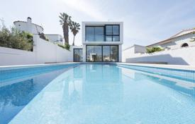 Houses for sale in Empuriabrava. Two-storey modern villa with a pool, a terrace and a pier, on the Grand Canal of Empuriabrava, Spain