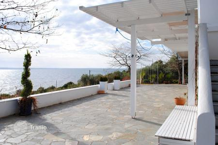 Luxury property for sale in Greece. Cozy villa with large windows on the first line of the sea, with a large veranda, in Sithonia, Chalkidiki region