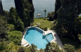 Houses for sale in Gardone Riviera. Ancient villa with a garden, a swimming pool and a private habour, in Gardone Riviera, Brescia, Italy