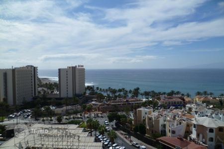 Apartments with pools by the sea for sale in Canary Islands. Apartment with a panoramic view of the ocean in the Playa de las Americas