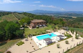 Houses for sale in Perugia. Renovated farmhouse with a pool, a garden and panoramic countryside views, Perugia, Umbria, Italy