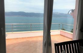 Apartments with pools by the sea for sale in Croatia. Comfortable apartment on the first line from the sea with a parking and a terrace in the house with a pool, Ciovo, Croatia
