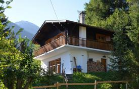 Houses for sale in Alps. Two-storey chalet with balconies, a patio and views of the Rhone Valley, Riddes, Valais, Switzerland