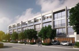 Townhouses for sale in North America. Modern luminous townhouse with two terraces, a view of the canal and a garage in a luxurious residence, near the beach, Bay Harbor Islands