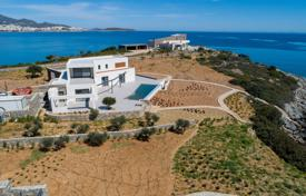 New villa with a terrace, a pool, sea views and a huge plot, on the first line of the beach, Ammoudara, Crete, Greece for 3,800,000 €