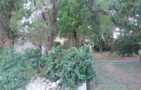 Development land for sale in Istria County. Small land plot with two garden houses, near the beach, Premantura, Istria County, Croatia