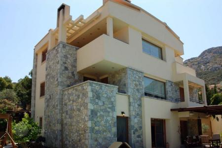 Houses with pools for sale in Attica. Modern villa at 90 meters from the beach, Sounion, Greece. Prestigious guarded residential complex with basketball and tennis courts