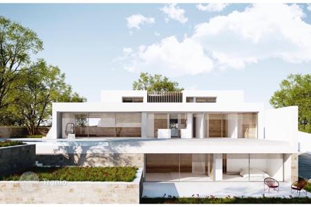 Apartments with pools from developers for sale in Alicante. Spectacular modern Mediterranean villa, located in Jávea (Costa Blanca), Spain. This luxury home combines design and functionality