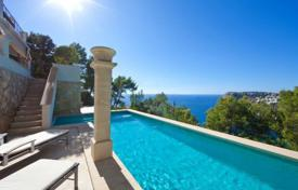 Luxury 4 bedroom houses for sale in Majorca (Mallorca). Comfortable villa with a garden, a swimming pool, a garage, a separate guest apartment and a sea view, Cala Llamp, Spain