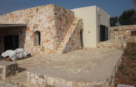 Stone villa in Mediterranean style with panoramic sea view for sale in Pescoluse. Price on request