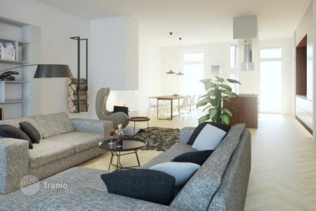 Townhouses for sale in Hessen. Townhouse with two spacious apartments, a garden and terraces, in Ostend area, Frankfurt, Germany