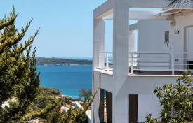 4 bedroom houses by the sea for sale in Porto Cheli. Snow-white villa in minimalist style, in Porto Cheli, Greece. House with convenient layout, a bay view, lounges, a garden, near the beach