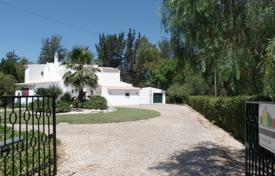 5 bedroom houses for sale in Algarve. Front line golf views, 5 bedroom villa with pool, near Alvor, West Algarve