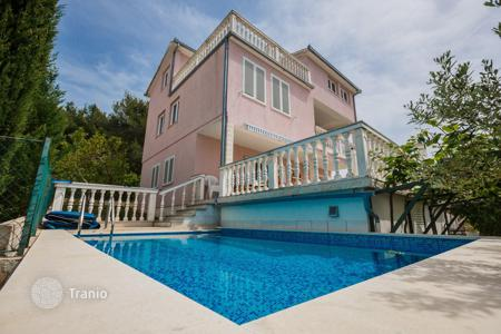 Houses with pools by the sea for sale in Dalmatia. Villa with pool and panoramic views of the sea in Okrug Gornji, Ciovo, Croatia
