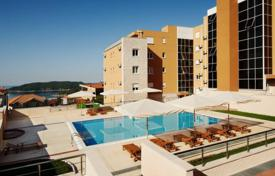 Apartments with pools by the sea for sale in Becici. The apartment is in a comfortable complex with swimming pool in Becici