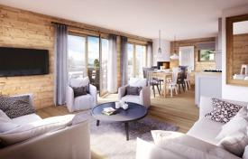 New homes for sale in Haute-Savoie. Three-bedroom apartment with a terrace and a sauna, in a new residence, next to the ski slope, Arâches-la-Frasse, Alpes, France
