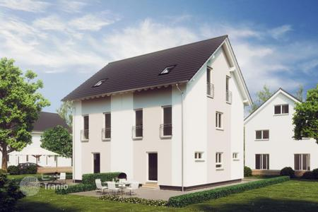 New home from developers for sale in Germany. Half of duplex with a garden and parking space in southern Bavaria