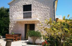Coastal property for sale in Brač. House with garden near the sea on the island of Brac, Croatia