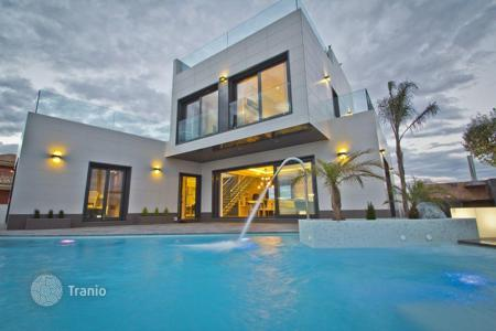 Houses with pools by the sea for sale in Costa Blanca. Luxury brand new villa near the sea in Orihuela Costa, Spain