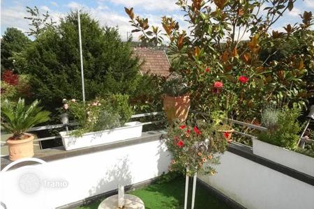 Property for sale in Lörrach. A cozy two-storey house with a terrace, a garden and a pond in Lörrach