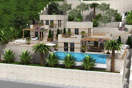Luxury houses for sale in Western Asia. New villa with guest house, private pool and a spacious terrace overlooking the sea in the center of Kalkan, Antalya, Turkey