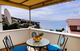 Coastal apartments for sale in Split-Dalmatia County. Penthouse with a private garden, a parking and a sea view, Ciovo, Croatia