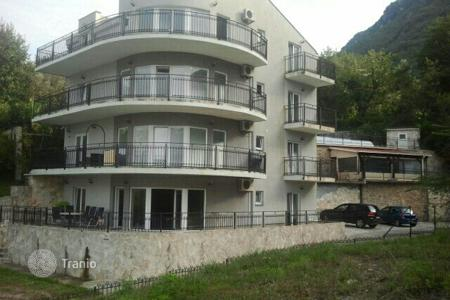 Coastal residential for sale in Kotor (city). The apartment is located in in a quiet, charming town Prcanj, the Bay of Kotor