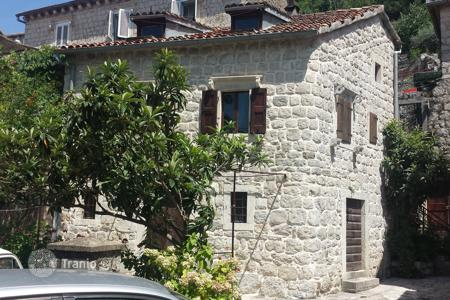 2 bedroom houses for sale in Kotor. Unique waterfront old stone house on two floors, has 90 square meters. It is located in Perast in the Bay of Kotor in the first sea line