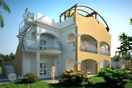 Apartments with pools by the sea for sale in Italy. The apartment has a garden, terrace and panoramic sea views in a residential complex of luxury, just minutes from the beach, in Calabria