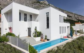 Property for sale in Split-Dalmatia County. Modern villa with a private garden, a pool, a garage, terraces and views of the sea and mountains, Makarska, Croatia