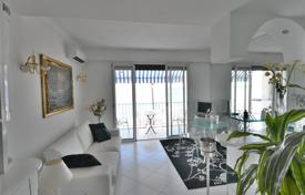 Apartments for sale in Antibes. Furnished renovated seaview apartment with a terrace, on the front coastline, Juan-les-Pins, France