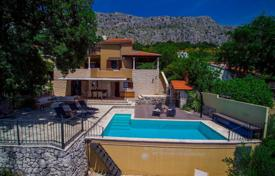 Coastal houses for sale in Split-Dalmatia County. Furnished villa with a plot, a pool, a garage and terraces, Omis, Croatia