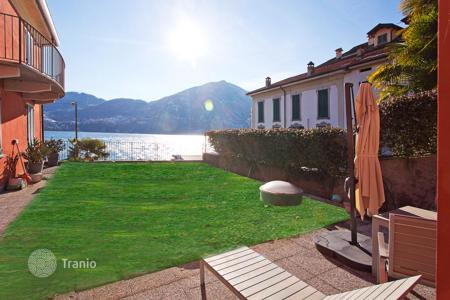 Bank repossessions property in Italy. Apartment overlooking the lake front at Tremezzo, complete with private garden