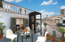 Townhouses for sale in Balearic Islands. Town house with patio and top terrace in Pollensa, Mallorca, Spain