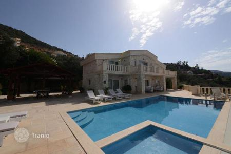 Luxury houses for sale in Western Asia. Three-storey villa with private access to the sea, spacious swimming pool and a terrace near the city center, Komurluk, Kalkan, Turkey
