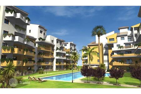 Cheap new homes for sale in Spain. New apartment with 3 bedrooms in a modern residential complex with swimming pool, parking and direct access to the beach, Punta Prima
