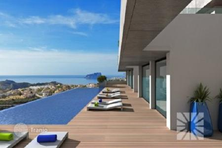 Apartments with pools from developers for sale in Costa Blanca. A new housing estate with the pool and a panoramic view of the sea in Cumbre del Sol, Spain