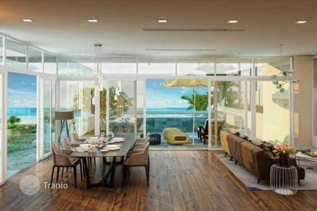 Cheap residential for sale in Southeast Asia. Apartment in a new beachfront residence with a business center, a gym and spa, Phu Quoc, Vietnam. Guaranteed rental income!