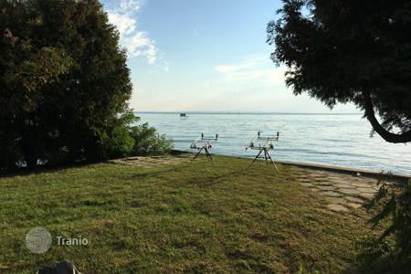 Property for sale in Veszprem County. CURIOSITY! PLOT for construction DIRECTLY ON THE LAKE BALATON WITH PRIVATE BEACH!