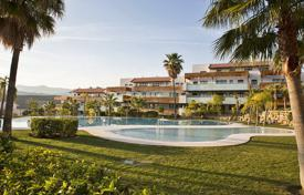 Apartments with pools for sale in Puerto Banús. Bright apartment with a garage, terraces and sea views in a residential complex with a garden, pools and a golf course, Puerto Banus, Spain