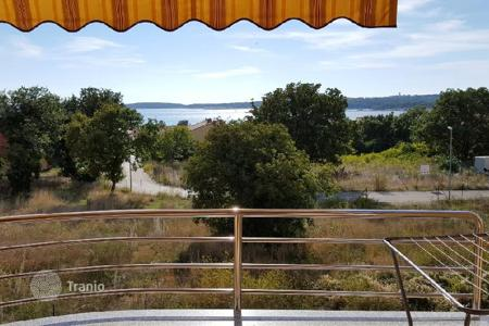 Cheap residential for sale in Medulin. Apartment MEDULIN. POŠESI. Beautiful view of the sea