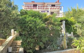 Property for sale in Split-Dalmatia County. Comfortable villa with a private garden, a barbecue, a parking and a sea view, Ciovo, Croatia