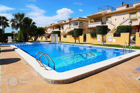Cheap residential for sale in Valencia. Townhouse with terrace and private garden, in a residence with swimming pool, in Dehesa de Campoamor, Alicante, Spain