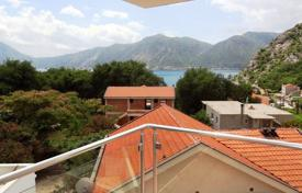 Cozy apartment with balconies and sea, mountain and forest views in a complex with garages and a barbecue area, Orahovac, Montenegro. Price on request