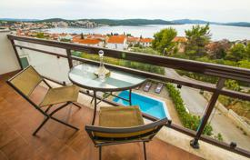 Apartments with pools for sale in Croatia. The three-level villa near the sea on the island of Ciovo, Croatia